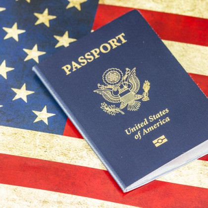 New Blue United States of America Passport isolated on US Flag