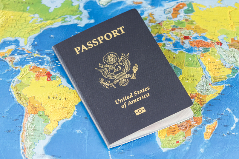 American passport over map of the world