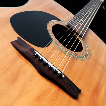 Acoustic guitar, focus on strings