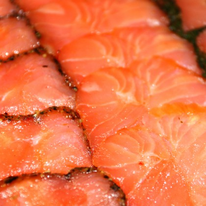 Smoked salmon background with herbs