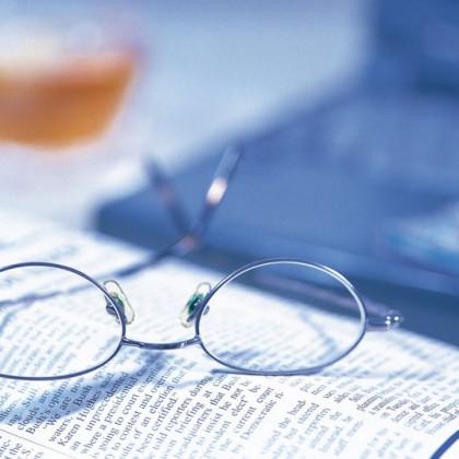 Glass and Newspaper