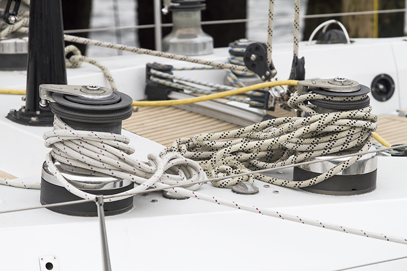 Line wrapped around winch of sailboat