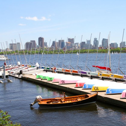 Boston Charles River with urban city skyline skyscrapers and boats