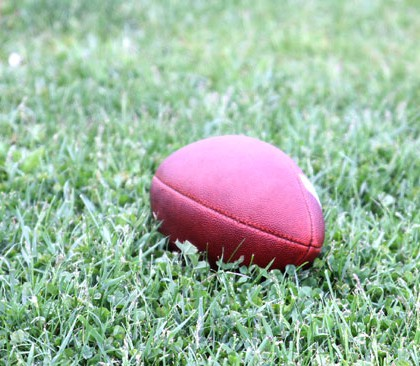 Football ball on a grass field
