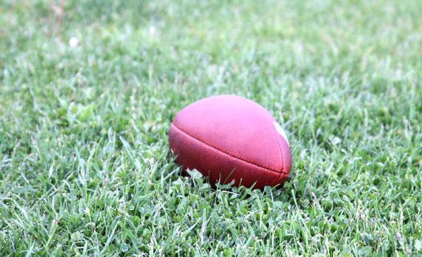 Football ball on a grass field