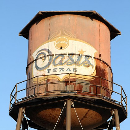 VINTAGE Water Tower against blue sky