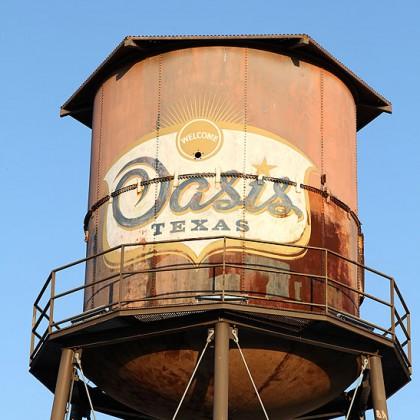 VINTAGE Water Tower against blue sky