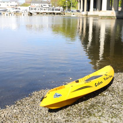 A bright yellow kayak on the beach