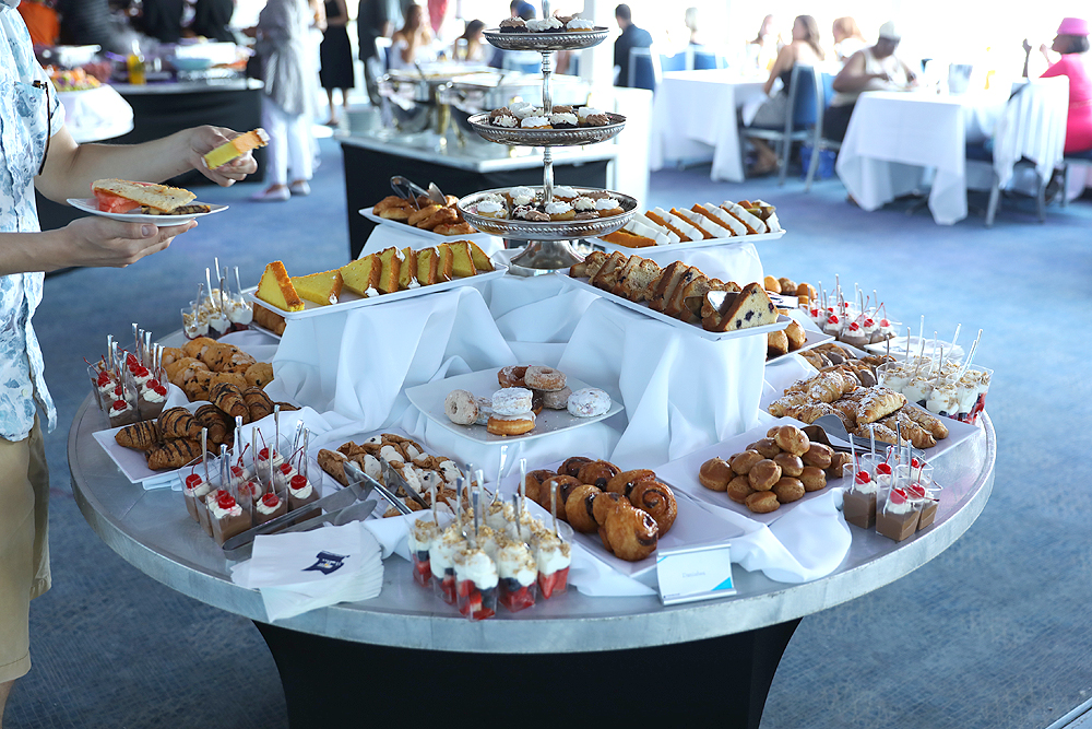 Delicious gourmet desserts displayed on a long buffet table