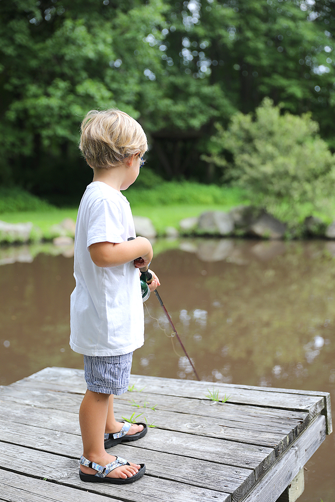Young boy Fishing from a dock in a river